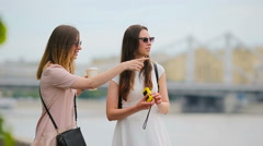 Young positive sisters having fun and making selfie. Concept of friendship and Stock Footage