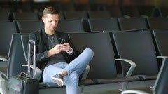 Urban business man talking on smart phone traveling inside in airport. Casual Stock Footage