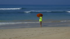 MODEL WALKING BEACH UMBRELLA MIDIGAMA SRI LANKA Stock Footage