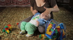 Beautiful kid does not listen to my mother at home. He was less than a year, and Stock Footage