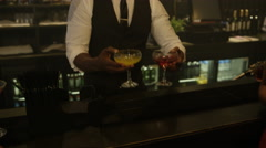 4K Barman serving drinks to happy young party crowd in trendy city bar Stock Footage