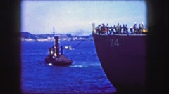 1944: Tugboat pulling USS General William Mitchell (AP-114) troopship maiden Stock Footage