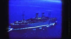 1944: Helicopter flyover of USS General William Mitchell (AP-114) troopship at Stock Footage