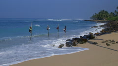 STILT FISHERMEN INDIAN OCEAN MIDIGAMA SRI LANKA Stock Footage