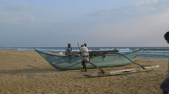 FIBREGLASS FISHING BOAT BENTOTA BEACH SRI LANKA Stock Footage