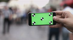 Smart Phone Held by Hand Green screen Chroma Key Tracking Motion Horizontal Stock Footage