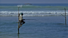 LONE STILT FISHERMAN SURFERS WELIGAMA SRI LANKA - stock footage