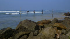 STILT FISHERMEN ROCKS WELIGAMA SRI LANKA ASIA Stock Footage
