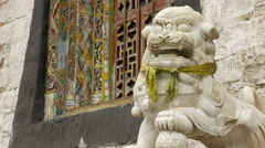 Marble lion statue in front of an ancient buddhist wooden temple Stock Footage