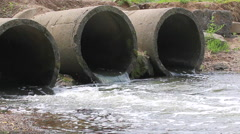 Concrete pipe from which the wastewater flows. Environmental pollution. Stock Footage