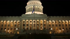 Flag flies at the amazing Utah State Capitol at night Stock Footage
