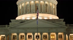 Flag flies at the Utah State Capitol at night Stock Footage