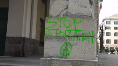 """Stop Deportation"" written on wall, Italy Stock Footage"