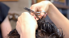 Barber teach his trainee to do a haircut - stock footage