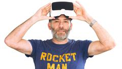 Mature man wearing virtual reality googles / VR Glasses Stock Photos