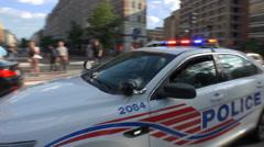 DC police cruiser, traffic, responding, siren Stock Footage