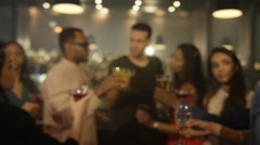 4K Happy young party crowd raise their glasses for a toast in city bar Arkistovideo