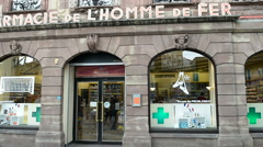 The iconic Pharmacie de l'Homme de Fer football people buy - stock footage