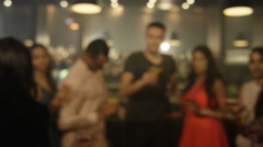 4K Happy young party crowd raise their glasses for a toast in city bar Stock Footage