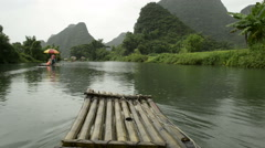 Cruise on a bamboo raft on Li river in Guilin, China Stock Footage