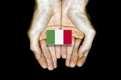 Flag of Italy in hands on black background Stock Illustration