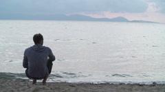 Man use smatphone on beach at sunset Stock Footage