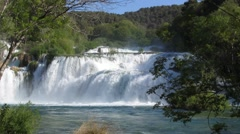 Wide waterfall cascade with much water falling down - stock footage