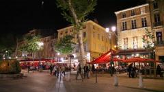 Major promenade street and restaurants at night in Aix-en-Provence, France Stock Footage