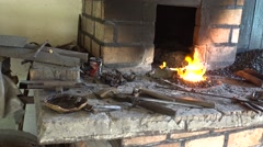 Panning blacksmith shop with burning fire Stock Footage
