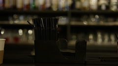 4K Panning shot of drinks, cocktail shaker and & other supplies on bar top Stock Footage