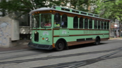 Green Bus Driving by in  Memphis Panning Shot Downtown Stock Footage