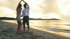 Young romantic couple dance at sunset on shore in summer outdoor Stock Footage
