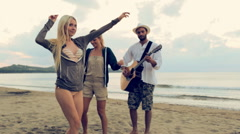 Group of four friend enjoy themselves playing guitar and dancing Stock Footage