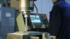 Preparation for drilling on a drilling machine, CNC dripping cutting fluid Stock Footage