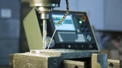 Adjustment feed cutting fluid worker, running a drill press - stock footage