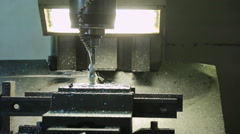 Process of drilling on the CNC machine and spraying of coolant Stock Footage