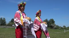 Tree Ukrainian girls with bread ready to meet guests 2 - stock footage