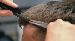 Barber Cuts the Hair in the Barbershop. Slow Motion. Close Up Stock Footage