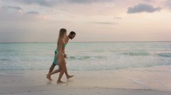Back view of young man woman couple in love enjoys and run Stock Footage