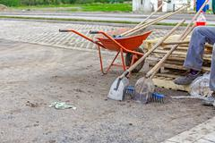 Wheelbarrow at the road works - stock photo
