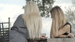 Two young women from behind wait for italian breakfast Stock Footage