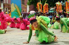 Corn festival street dancers at church square - stock photo