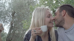 Romantic couple of happy man and woman in love, smile and kiss - stock footage