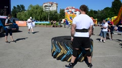 The athlete lifts a wheel. Stock Footage