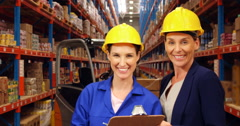 Warehouse worker holding a clipboard Stock Footage