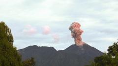 Reventador Volcano erupting at dawn, November 2015. Stock Footage