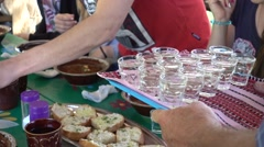 Serving vodka to group of tourists at the set table - stock footage