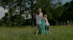 Family in the summer sunny day in the park. Children playing with their parents Stock Footage