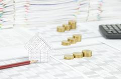 House with pencil have blur step gold coins as background Stock Photos