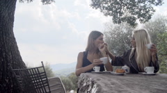 Happy women, couple in love, smiles, eat croissant and drink coffee Stock Footage